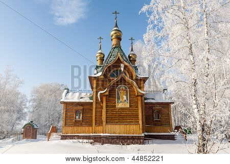 Vintage wooden Church in snowy forest