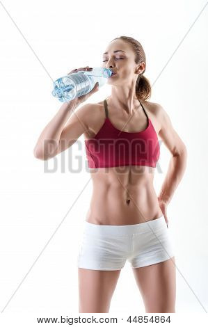 Young Woman Hydrating After Exercise