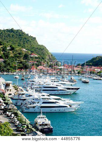 Aerial view at Gustavia Harbor with mega yachts at St Barts.