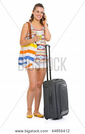 Young Tourist Woman With Wheel Bag Talking Mobile Phone