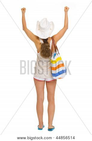 Full Length Portrait Of Beach Young Woman Rejoicing Success . Re