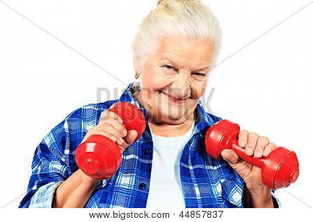 Happy grandma doing exercises with dumbbells. Isolated over white.