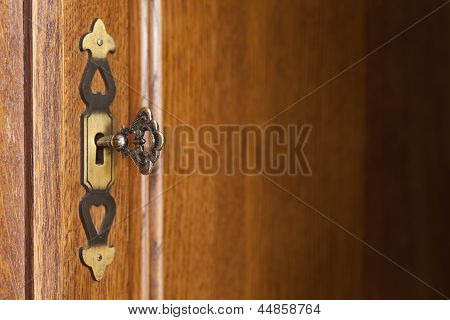 Wooden Background With Doorplate And Key