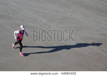 JACKSONVILLE, FLORIDA - FEBRUARY 17: Female runner, Kim Pawelek Brantly, on the beach leg of the 6th Annual 26.2 with Donna Marathon on February 17, 2013 in Jacksonville, Florida.
