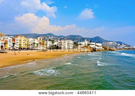 SITGES, SPAIN - MARCH 3: View of ocean front walk and Ribera Beach on March 3, 2012 in Sitges, Spain. This urban beach, is 205 meters long and 20 meters wide