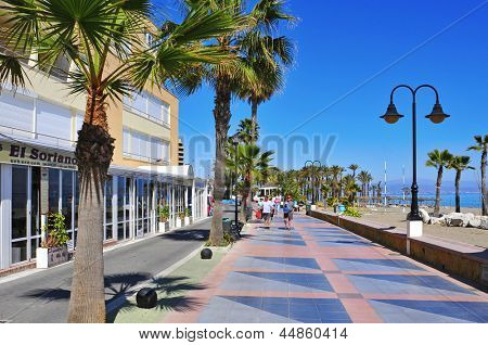 TORREMOLINOS, SPAIN - MARCH 13: Ocean front walk and Bajondillo Beach  on March 13, 2012 in Torremolinos, Spain. This popular beach is about 1,100 meters long and 40 meters average width