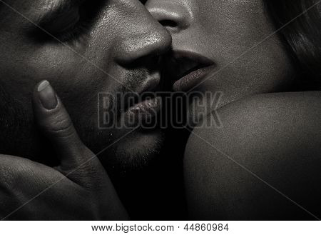Close up portrait of a kissing couple
