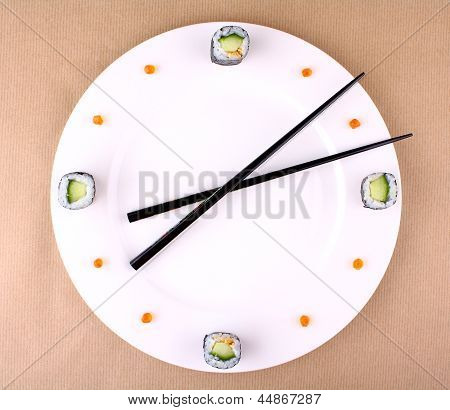 Sushi Clock, Time Concept With Caviar On A White Plate