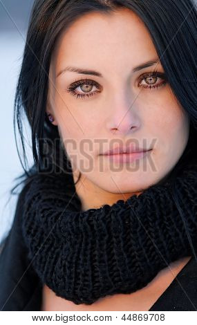 Brunette girl portrait - winter cold effect