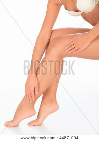 Perfect long female legs against white background.