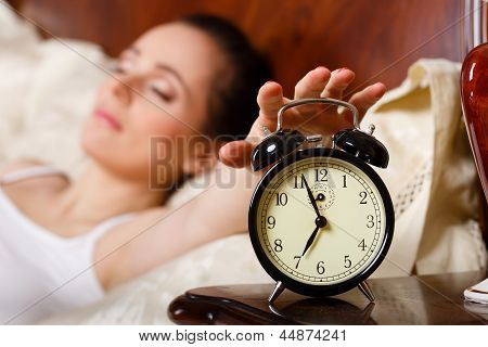 Young Woman Sleeps In Bed In The Bedroom.