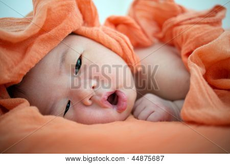Newborn Asian baby girl awake, 7 days after birth