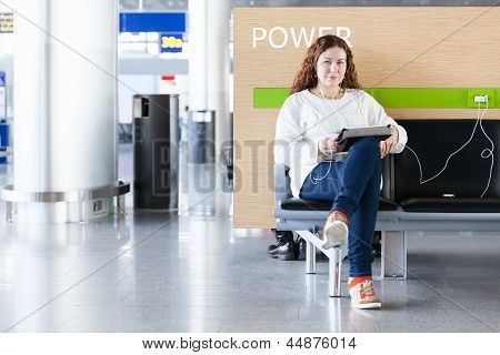 Woman With Electronic Devices Near Place To Charge Your Phone. Copyspace