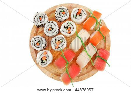 Maki and Nigiri Sushi - California Roll with Avocado and Salmon, Cream Cheese and Raw Salmon inside with nigiri topped raw Salmon Tuna and Eel . isolated over white background