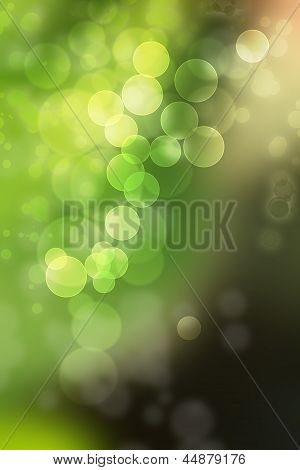 Abstract background in shades of green, yellow and black