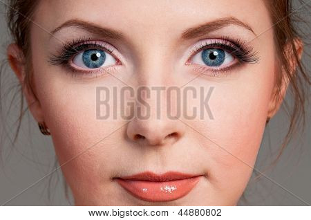 Close-up portrait of caucasian girl with beautiful blue eyes