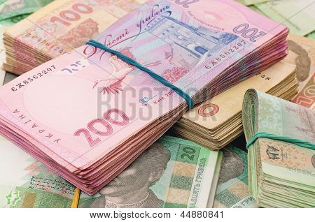 Heap of ukrainian hryvna, on moneys background
