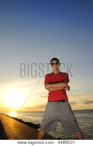 Man Standing At Sunset