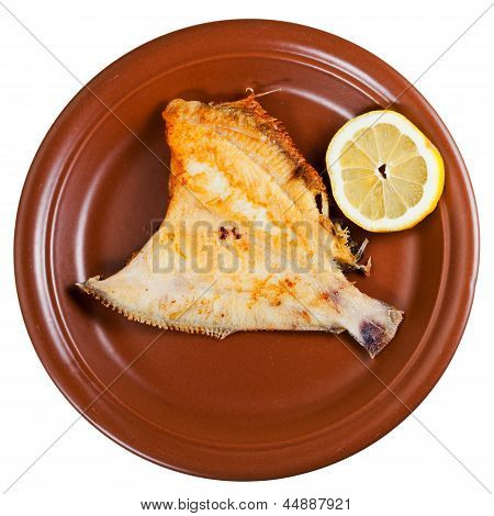 Fried Sole Fish On Brown Plate