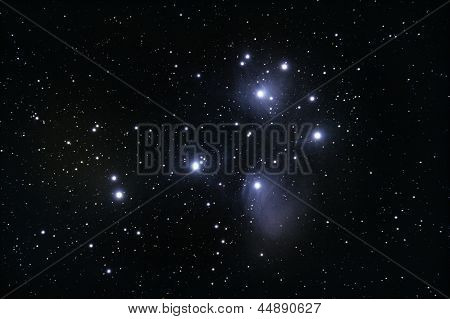 M45 Pleiades open cluster, real astronomic picture, stars background.