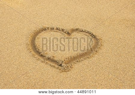 Heart Drawn In The Sand Of A Beach