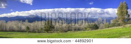 Snowy Mountains And Green Valley In Sierra De Gredos, Avila, Spain