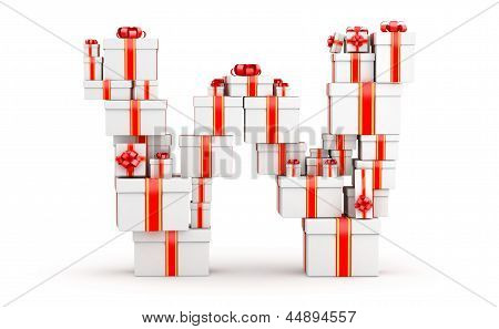 Letter W from boxes of gifts decorated with red ribbons