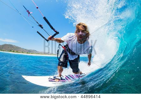 Extreme Sport, Kite Surfer Riding Wave getting Barreled