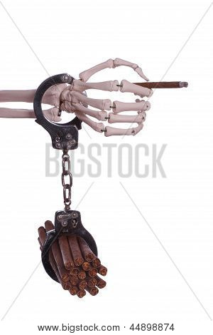 skeleton hand holding cigar with handcuff