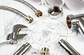 stock photo of structural engineering  - plumbing and drawings are on the desktop - JPG
