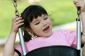 Cute Little Girl Swinging poster
