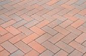 stock photo of driveway  - Red block pavior driveway with herringbone design - JPG
