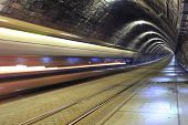 stock photo of tram  - A tram disappearing into a metro tunnel - JPG