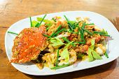 picture of cooked crab  - cooked curry crabs with spicy sauce on white plate - JPG