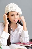Beautiful student girl wearing a beret.