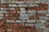stock photo of wallow  - red brick wall is slightly worn and wallow - JPG