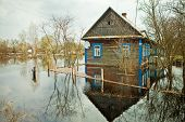 stock photo of accident victim  - Flooded homes and plots of land in the villages during the spring flood of the river Pripyat - JPG