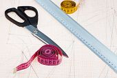 image of tailoring  - dress pattern at graph paper and tailors shears ruler measure tapes - JPG