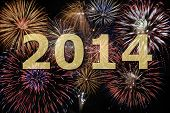 stock photo of firework display  - new year 2014 with firework at midnight - JPG