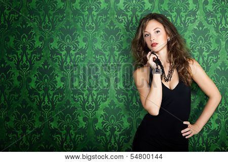 Beautiful Gorgeous Model Posing In Green Vintage Room