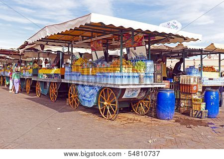 Market stall with fruits on the Aa el Fna square and market place in Marrakesh's medina quarter in Morocco