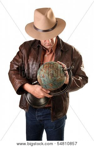 Adventurer treasure hunter with vintage globe