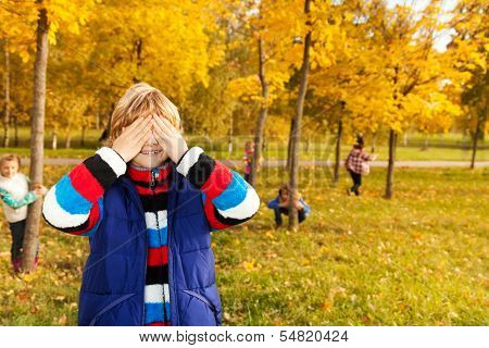 Boy Counting While Friends Hiding