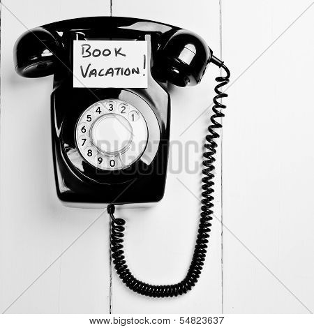 Retro Phone With Book A Vacation Reminder Message