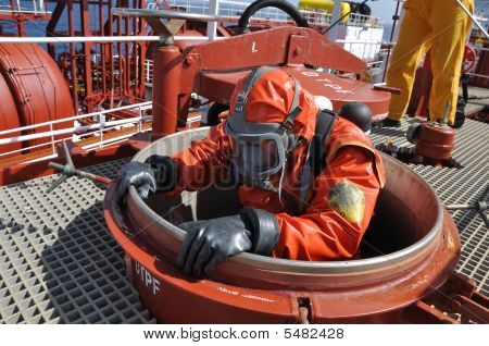 Man In Chemical Suit On Ship Deck