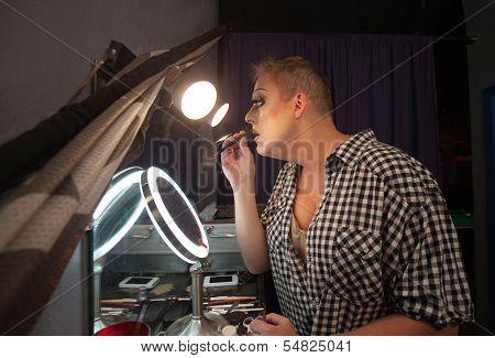 Man Using Lipstick Pencil