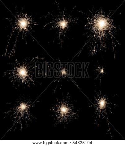 Set Of Burning Sparklers On Black Background.