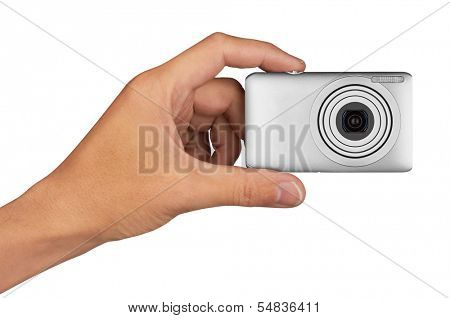 Digital camera in hand, isolated on white background