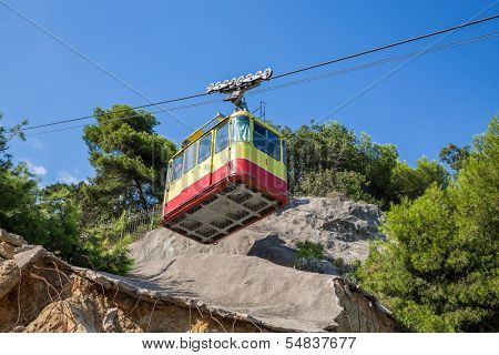 Funicular travels through places with partially destroyed the iron-concrete shield against landslides