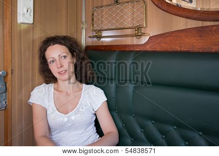 Girl in business-class compartment on the train
